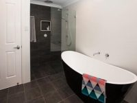Bathroom renovation – statement black bath